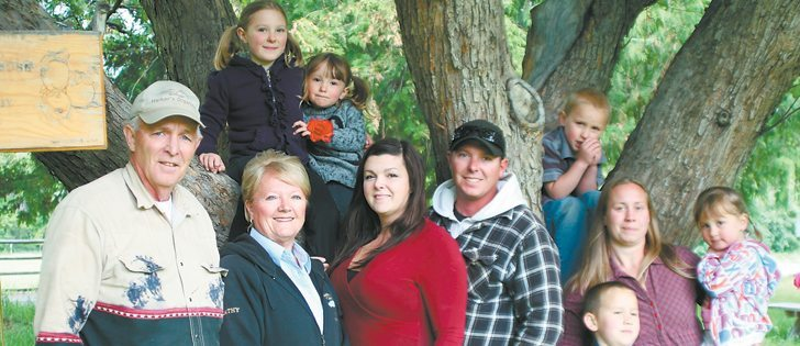 Several generations of Harkers gather beside a 100-year-old apple tree on their farm at Cawston, B.C. On the left are Bruce and Kathy Harker, Sara and Troy and sister Tyla with her children, Garrison and Grace. Son Tyson is behind her. Sara and Troy's daughters, Kaydence and Akaya are in the tree. Sara and Troy were named 2012 outstanding young farmers for British Columbia. They say diversification has allowed them to keep farming. Harkers Organics started Rustic Roots winery, using local organic fruit.  |  Barbara Duckworth photo