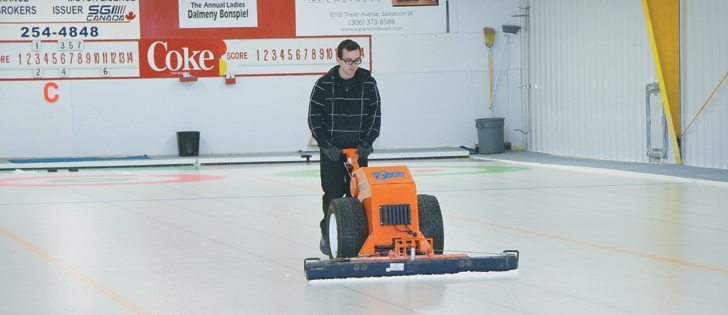 Ice technician James Gordon has been perfecting his craft for a decade and knows what makes curling rocks sail on the ice. He is one 20 volunteers who will travel to Sochi, Russia, for the Winter Olympics.  |  Karen Morrison photo