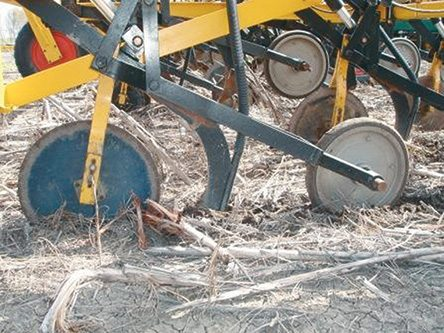 The optional coulter is used to clear trash ahead of the shank. The machine is capable of very deep planting, or very shallow, depending on the conditions.   |  Multi Farming Systems photo.