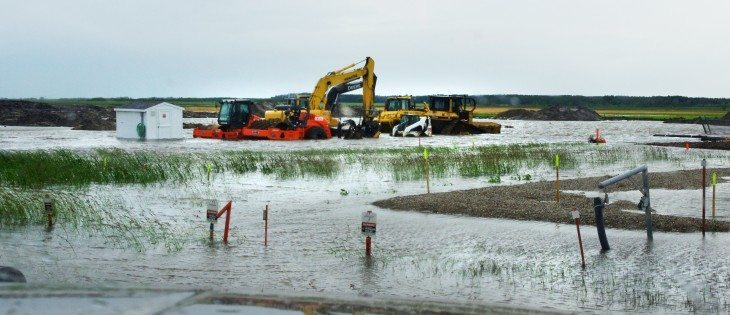 June 29, 2014 north of Souris, Manitoba on Highway 250 after 102 mm of rain fell in 24 hours.Enbridge pipeline equipment buried in the heavy rainfall.  |  Diane Winters photo