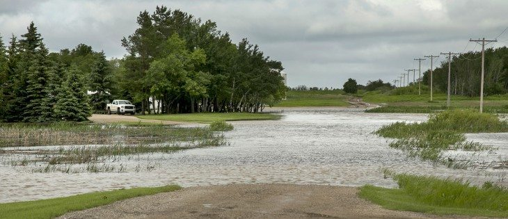 Heavy rain flooded a farm lane, west of Melville, Sask., on Highway 15.  |  Robin Booker photo