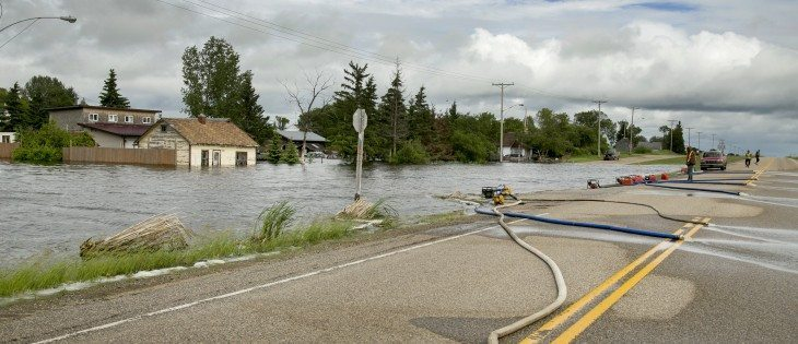 Residents of Fenwood try to pump out the town. Laurie Stopa, a resident of the town said a neighbour woke him up at 4 a.m. on June 30. He said the water was juststarting to run into the town, and within two hours his house was flooded.  |  Robin Booker photo