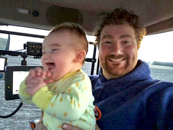 Dustin Wiens ‏@DtotheIzzoAcres First tractor ride for my almost 6 month old Leo. #greatestthingever#agchat #plant14 @The Western Producer