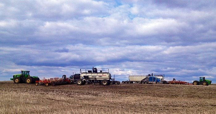 dlfidek Seeding on the Fidek Farm with two matching units and twin brothers doing the seeding