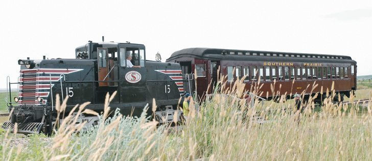 Southern Prairie Railway engineer Devon Generous hooks onto the Pullman Coach for its return trip to Ogema, Sask. The SPR locomotive is a fully-restored 1945 GE 44-Tonner Center Cab. SPR organizers found the locomotive in North Conway, New Hampshire.  |  Brian Cross photo