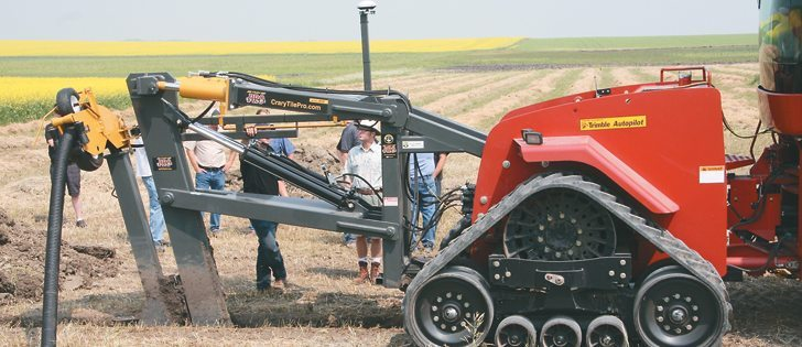 Excessive moisture for several years has sparked interest in tile drainage, said Mike Kleckner during an installation demonstration at a MJK Ag Ventures field day near Rouleau, Sask.  |  Karen Briere photo