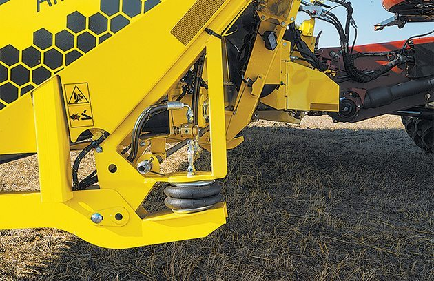 Air bags fed from an electrically powered compressor manage the flex system, allowing for easy control in changing conditions.  |  Honey Bee photo
