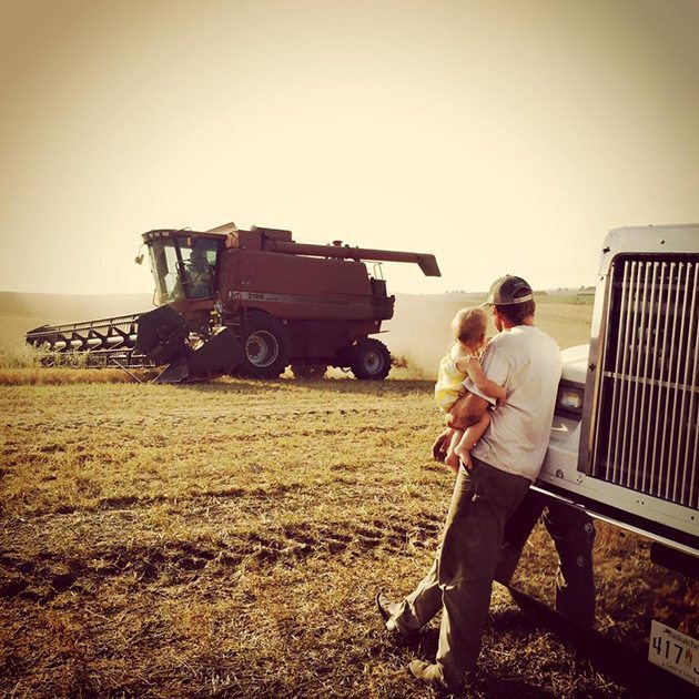 Megz Reynolds‎ #Harvest15 5th generation farmer in the making. She had her first combine ride last year when she was a month and a half old and would accompany her mom while she was combining.