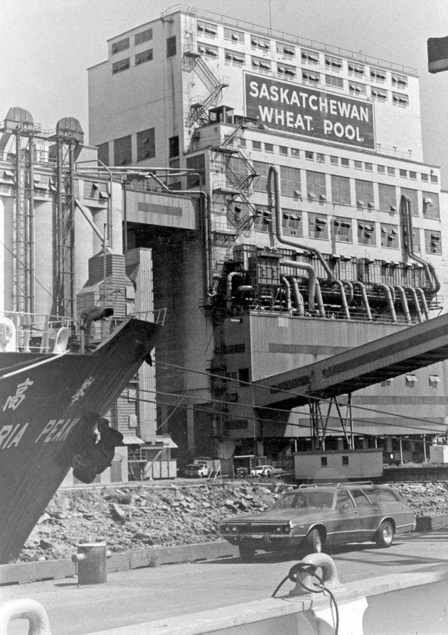 Note the new dust control equipment that had recently been installed on Saskatchewan Wheat Pool's grain terminal in Vancouver. The photo, which was taken from the deck of a loading grain ship, was taken in the summer of 1978.  |  File photo
