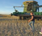 Hayden Grunerud, 10, and her five-year-old sister, Emma, follow Norman Ballek to his combine for a few circuits around the canola field south of Broderick, Sask., Sept. 14.  |  William DeKay photo