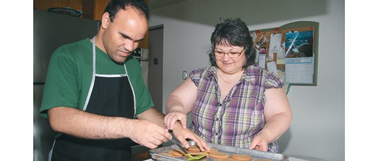 Evelyn Yelinek helps her son, Devon, with his cookie making business at Swan River, Man. Devon, who is blind and autistic, prepares cookie orders for individuals and groups. | Karen Morrison photo