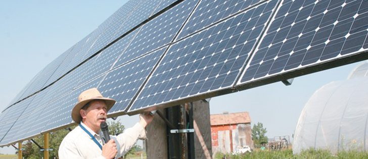 Vern Bretin explains how his large solar powered unit works on his greenhouse near Calgary. His operation is in a good location to take advantage of solar power.  |  File photo