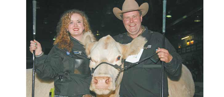 Megan and Rod McLeod of Cochrane, Alta., shared a father-daughter moment when their cow won supreme champion.  |  Barbara Duckworth photo