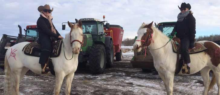 Bill 6 protestors on horseback in Leduc. | Mary MacArthur photo