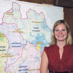 Shannon Frank, executive director of the Oldman Watershed Council, stands in front of a map of the watershed.  |  File photo