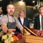 Blair Lebsack, chef of the Rge Rd restaurant in Edmonton, shows Agriculture Minister Oneil Carlier (right), producer Jason Andersen (centre) and MLA David Shepherd food his restaurant prepares with local ingredients. | Jeremy Simes photo