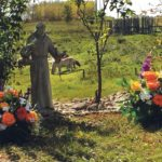 The Eirickson family cemetery is on a slight knoll overlooking a lush green pasture and the gently sloping ravine that runs through it.  A statue of St. Francis of Assis watches over the graves of  Oli and Irene Eirickson, laid to rest there in 2010 and 2013. |  Shirley Byers photo