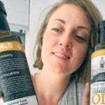 Elysia Vandenhurk of Three Farmers Foods displays the traceability labelling on their camelina oil.  |  William DeKay photo
