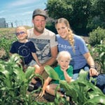 Liam Gauthier and Megz Reynolds hang out in the family's vegetable garden with their children, Thea, 4, and Rynn, 2.  |  William DeKay photo