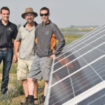 Daniel Visser of Western Solar, left, helped three southern Alberta farming operations set up a 300 kW solar system to operate irrigation pivots. Among the farming partners are Ron Lamb, centre, and Ben Fankhauser. The irrigation system draws water from nearby Clear Lake.  |  Barb Glen photo