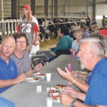 People had breakfast alongside the dairy cows during a Breakfast on the Dairy Farm event held at Airport Dairy near Fort Macleod, Alta., Aug. 11. The dairy, operated by Harvey and Bernita Van Hierden, opened its doors to the public for the event, which was organized by Alberta Milk.  |  Barb Glen photo