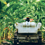 The EarthSenseTerraSentia  is a 25 pound autonomous robot that roams cornfields plucking out herbicide resistant weeds.   When it hits the market, the device will initially cost less than US$100 per acre per season to operate.   The developer says he can make a narrower unit that can work in 15-inch row spacings now used by some Canadian prairie farmers.  |  EarthSense photo