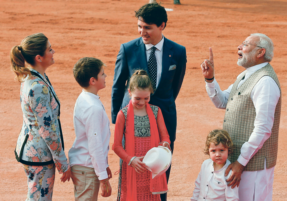 Prime Minister Justin Trudeau, seen here with his family, and Indian Prime Minister Narendra Modi, agreed during a meeting in February to resolve the fumigation issue by the end of the year. That deadline has come and gone.  | REUTERS/Adnan Abidi PHOTO