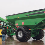 The Brandt 1520XT attracted attention at Regina's Farm Progress Show, despite the heavy rain. The new design kicks the 20 inch auger 7.5 feet forward from the hitching point, allowing the tractor operator to look to the side with unloading, rather than back.  |  Michael Raine photo