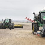 Now with 24 inches of moisture this season, the Woolliams farm in the foothills near Calgary has a few ruts to fix. But running a single sprayer on a 9,000 acre operation appears to work.  |  Michael Raine photo