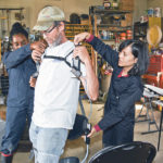Mechanical exoskeletons may one day reduce effort, injury risks for farmers