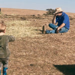 Jason Wright struggles with his emotions in front of his son. The farmer is among many Australian producers facing devastation as a year-long drought continues.  |  Amber Wright photo