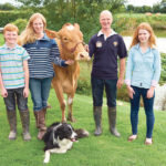 Katharine and Jason Salisbury farm in England with their children, James and Emily. Also in the photo is Edd the sheepdog and one of their pedigree Guernsey cows.  |  Salisbury family photo