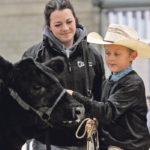 Kurt Pedersen of Pedersen Livestock stands with Kaylee Duncan. He won the Pee Wee Grand Champion title at Edmonton Farmfair last week.  |  Jeremy Simes photo