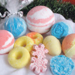 Use a variety of shapes to mould bath bombs, such as plastic bath bomb moulds, separating plastic ornaments, doughnut muffin pans, silicone snowflake moulds, plastic Easter eggs or muffin pans. Place in a small plastic bag and tie with a ribbon along with a note indicating the essential oil that was used. Miniature bath bombs can be used for soaking hands before a manicure or to relax feet.  |  Betty Ann Deobald photos