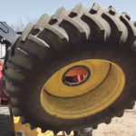 Tire Jogger helps farmers handle big tires hands-free