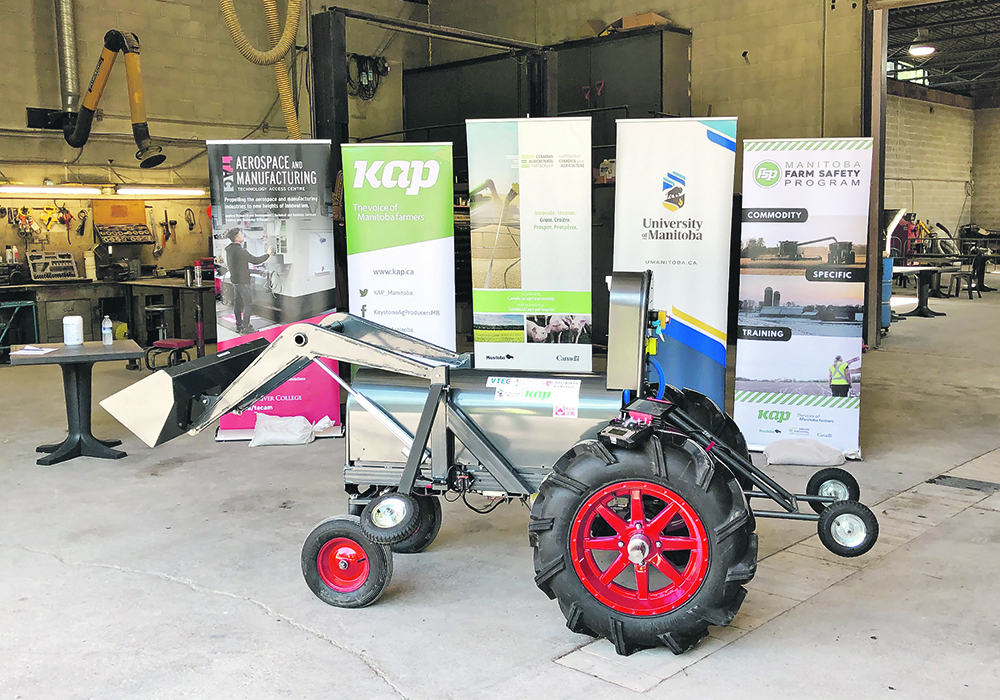 The University of Manitoba, Red River College and Keystone Agriculture Producers worked together to develop the mini-tractor.  | Submitted photo