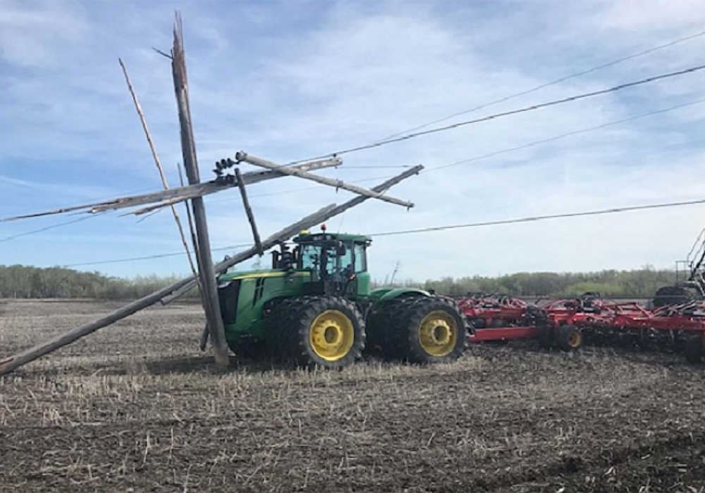 In 2020, there were 188 cases where a cultivator, seeder or another implement crashed into a pole or snagged a wire somewhere in the province. | Twitter/@manitobahydro photo